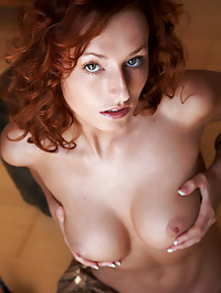 Bigger breasts and longer legs on this red head who loves to smile and makes everyone happy.
