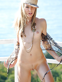 Whites and blues are the theme in this outdoor shoot with hot blonde Nika.