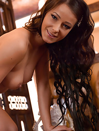 Luca Helios captures the fun and spontaneous Melissa as she shows off her athletic, well-toned physique, performing a slow, sensual striptease of her frilly blue lingerie.