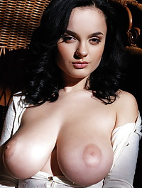 Raven-haired Lana with her amazing, large breasts and stockinged feet.