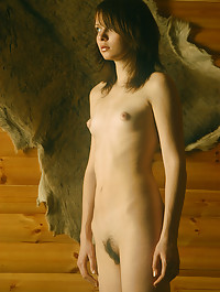 Classic shoot of beautiful brunette in the hunting lodge.