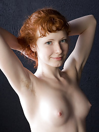 Rochelle is a cheerful redhead with enviable alabaster skin, slender physique, pink and perky nipples, and a cute bush.