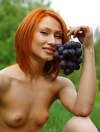 Enticing redhead with luscious, pink labia, and small but puffy breasts.