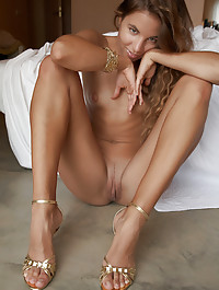 Long legs and a beautiful girl getting naked