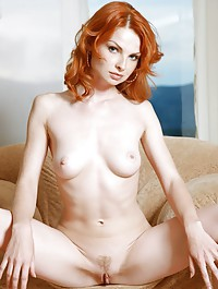 Fiery redhead with pale and smooth body with lusty appeal.