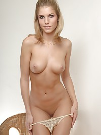 Slow and sensual striptease from an elegantly seductive blonde.