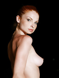 Against the dusky background, Natalia confidently flaunts her slender physique with perfectly round and erect breasts, slim waist and athletic legs.