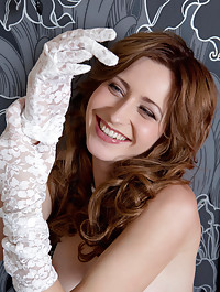 With a gorgeous smile on her face, Janelle confidently flaunts her pretty feet and sexy, slim waist in delicate white lace stockings.