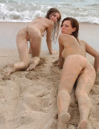 2 hot girls out on the beach licking each other