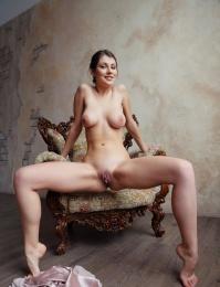 A pretty girl with little titties is feeling slutty
