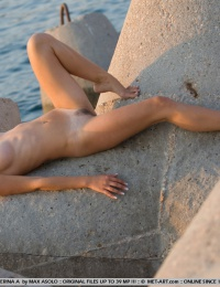 Crazy hot model with brown hair naked on the beach