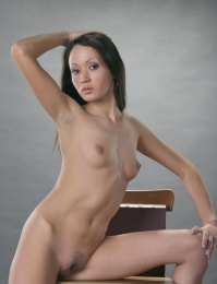 Elegant model with exotic looks and petite charms