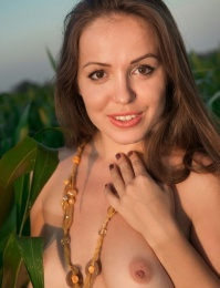 Farmers daughter in the wheat field naked