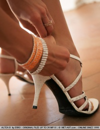 high heels and a smile in this indoor shoot