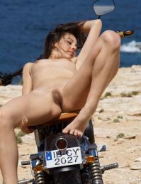 Hot biker girl gets naked on the bike