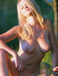 hot blond girl showing her firm body in these nymph pictures