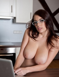 Hot busty milf at home looking as horny as ever