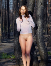 Hot girl in the woods showing her little nipples