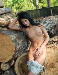 Hot girl out and about in the woods showing her tanned sexy body