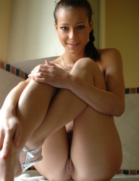 Hot girl playing in the bath tub with her self