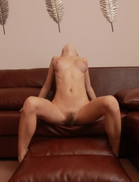 hot girl with a hairy pussy on a couch