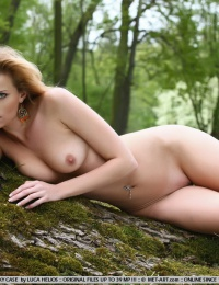 Hot girl with a super tight body is in the woods naked