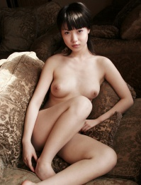 Hot young Asian girl shows us her nice young boobs