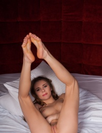 Kaite's lusty and enticing body sprawled on top of the bed