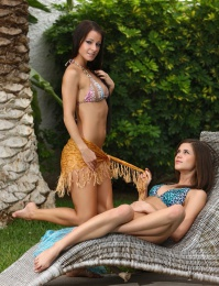 Model Caprice and her friend by the pool naked