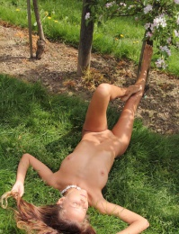 Naked girl in the orchard