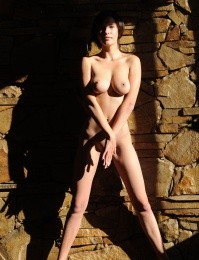 Naughty girl in a fur coat getting naked