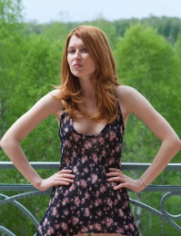 Naughty redhead out doors