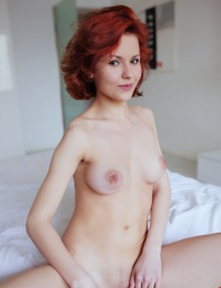 Nice boobs on a unnatural redhead
