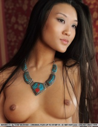 Oriental girl shows us her great set of boobs