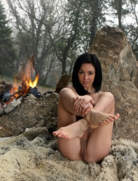 out side by the camp fire getting naked