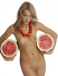 Pretty blonde girl gets a little messy with a fat melon