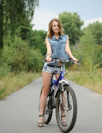 Pretty girl gets off her bike and shows us her young body