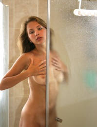 Sexy chick in the shower all soapy and naked