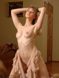skinny naked blond girl with pale skin