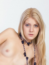 Tiny nipples out and her only clothes being purple stockings
