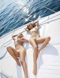 Two hot girls on a boat showing off there great rear ends