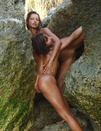 Two naked models all wet in a secret lagoon