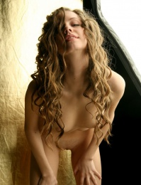 Young chick with curly hair naked